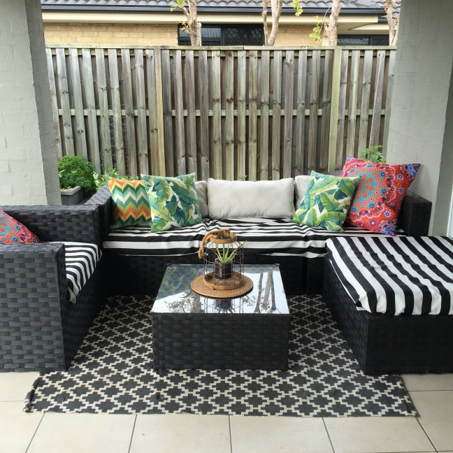 outdoor area leaf print cushions